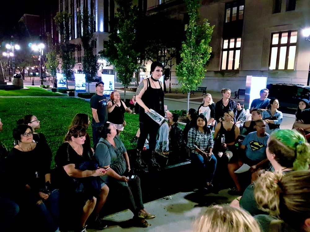 "Stephanie ""Spooky Steph"" Dumbreck telling us a tale in Gore Park during Haunted Hamilton ghost tour"